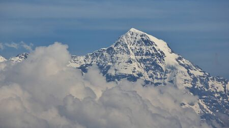 monch: Famous mountain in the Swiss Alps. Mt Monch. Stock Photo