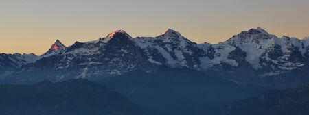 eiger: Famous mountains Eiger Monch and Jungfrau. Morning scene in Switzerland.