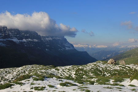 glarus: Scene after snowfall in Summer. View from a place near Klausenpass towards Glarus. Swiss Alps.