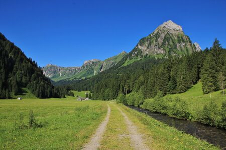 glarus: Summer landscape in Glarus Canton, Swiss Alps. Scene on the hiking route from lake Obersee to lake Kl�ntalersee. Mt Brunnelistock. Stock Photo