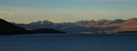 tekapo: Lake Tekapo and mountains. Evening scene in the Southern Alps, New Zealand. Stock Photo