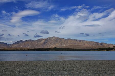 Summer scene at Lake Tekapo. Clouds over the Two Thumb mountain range. Landscape in New Zealand. Stock Photo