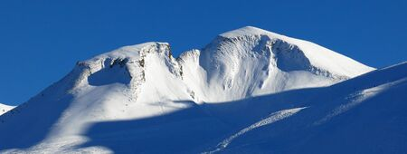 Ski Area: Beautiful shaped mountain Chalberstockli. Winter scene in Stoos, Swiss Alps. Ski area.