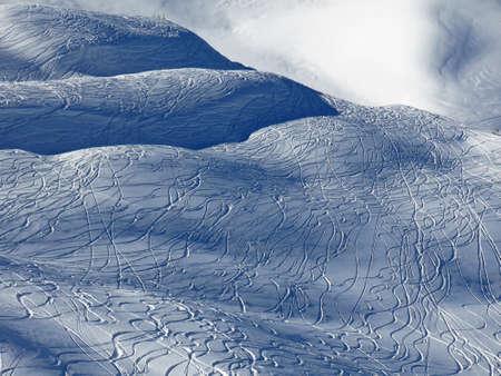 powder snow: Winter scene in the Stoos ski area. Ski and snowboard tracks in powder snow.