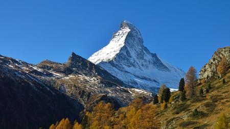Majestic mountain Matterhorn after snowfall in autumn. Stock Photo