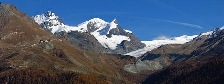 snow capped mountains: Landscape in Zermatt. Findelgletscher. Snow capped mountains Mt Adlerhorn, Mt Strahlhorn and Mt Rimpischhorn. Stock Photo