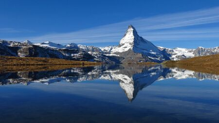 Famous mountain Matterhorn reflecting in lake Stellisee. Autumn scene in Zermatt.