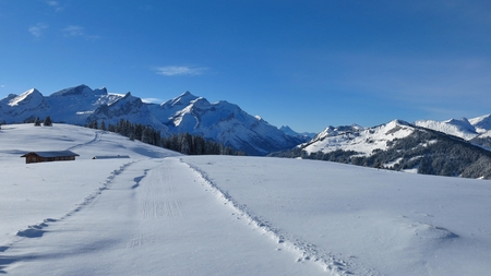 Snow covered mountains near Gstaad, Swiss Alps. View from Mt Wispile.