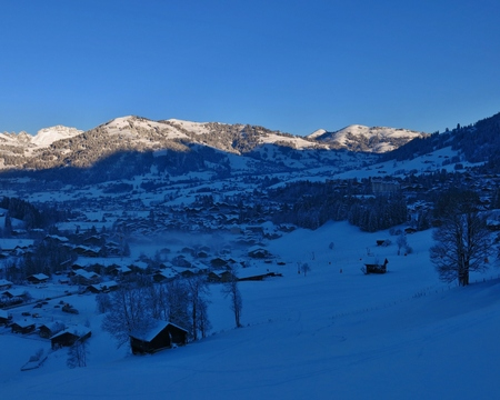 saanenland: Sunrise on a beautiful winter morning in Gstaad. Famous village and travel destination in the Swiss Alps.