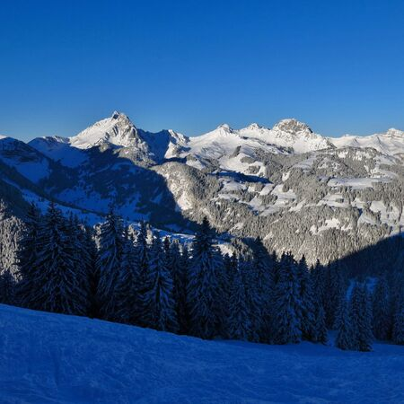Winter morning in the Swiss Alps. View from the Wispile ski area. Mt Videmanette.