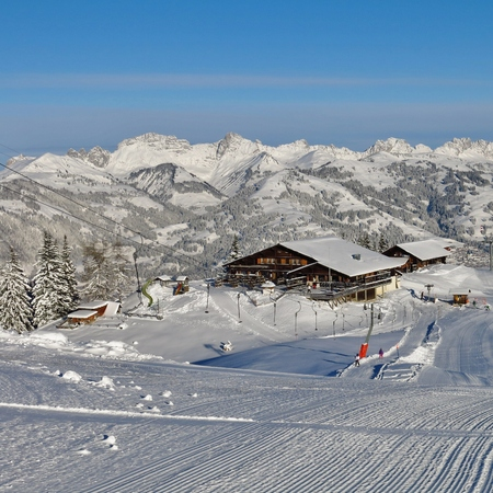 Summit station and restaurant on top of Mt Wispile. Ski area in Gstaad. Snow covered mountains. Editorial