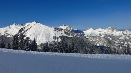 Snow covered mountains near Gstaad, Switzerland. View from Mt Wispile.