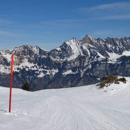 Ski Area: Scene in the Flumserberg ski area, Switzerland. Slope and mountains of the Churfirsten Range.