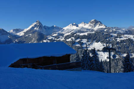 gstaad: Snow covered mountains in Gstaad. Mt Videmanette. View from the middle station of the Wispile ski area, Switzerland.