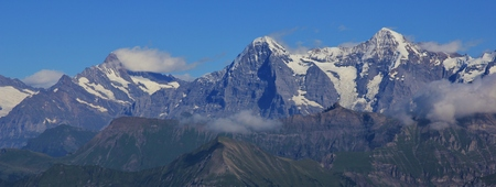 monch: Eiger North Face. View from Mt Niesen. High mountains Finsteraarhorn, Eiger and Monch in summer.