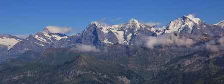 monch: Famous mountains Eiger, Monch and Jungfrau in summer. View from Mt Niesen. Swiss Alps. Stock Photo
