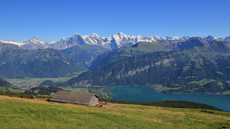 jungfrau: View from Mt Niederhorn, Bernese Oberland. Lake Thunersee. Mt Eiger, Monch and Jungfrau. Summer scene. Stock Photo