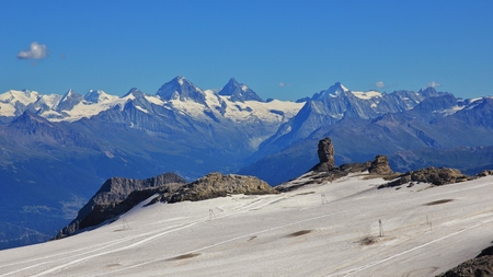 saanenland: Glacier de Diablerets and Quille du Diable, famous rock. Distant view of the Matterhorn and other high mountains in Switzerland.