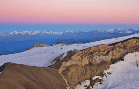 pink sunset: View from Scex Rouge, Glacier de Diablerets. Pink sunset in the Swiss Alps. Stock Photo