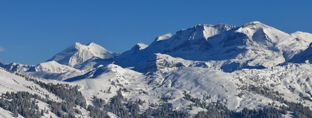 View from Mt Hohe Wispile. Snow covered mountains in the Bernese Oberland. Winter scene in Gstaad.