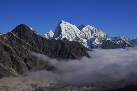 Snow capped mountains Cholatse, Tabuche and Ama Dablam. High mountains of the Himalayas. Stock Photo