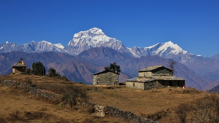 Scene in tha Annapurna Conservation Area, Nepal. View from a place near Gorepani. High mountains Dhaulagiri and Tukuche Peak.