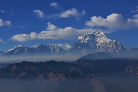Seventh highest mountain in the world. Mount Dhaulagiri. Cloudy autumn day.