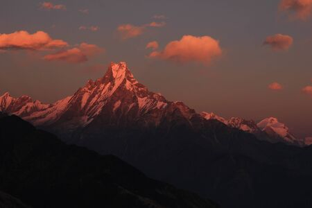 Evening scene in the Himalayas. Famous fish tail mountain Machapuchare, Nepal. Stock Photo