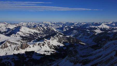 saanenland: View from Glacier de Diablerets, Swiss Alps. Saanenland valley in winter.