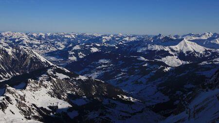 saanenland: View from the Glacier de Diablerets ski area, Swiss Alps. Saanenland valley and distant view of Gstaad.