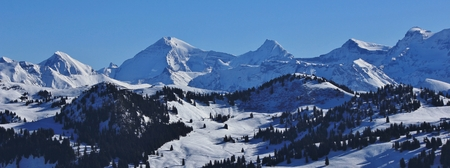 View from the Rellerli ski area, Switzerland. Snow covered mountain range in the Bernese Oberland.