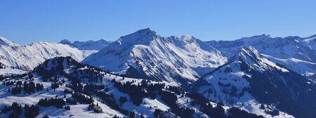 Winter landscape in Gstaad, Swiss Alps. Hornberg, Giferspitz and Wasseregrat seen from the Rellerli ski area.