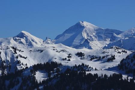 Winter landscape in the Swiss Alps. Saanersloch ski slopes and mount Wildstrubel.