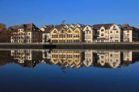 Scene in Schaffhausen, Switzerland. Row of houses reflecting in the river Rhine.