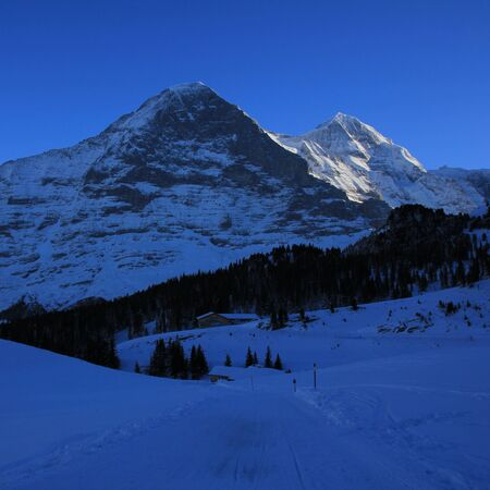 monch: Famous Eiger north face in winter, Switzerland.