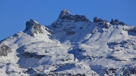 glarus: Snow covered mountain Gross Charpf. Mountain in Glarus Canton. View from Braunwald. Stock Photo