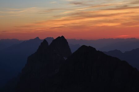 Colorful sunset in the Swiss Alps, view from mount Titlis. Summer scene.
