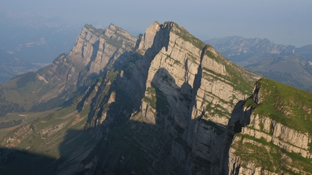 Churfirsten range seen from Chaserrugg. Summer morning in the Swiss Alps.