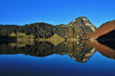 Mount Gross Aubrig mirroring in lake Wagital. Autumn scene in the Swiss Alps.