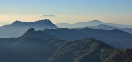 Early morning in the Annapurna Conservation Area, Nepal. View from Ghale Gaun. Hills covered by forest and valleys.
