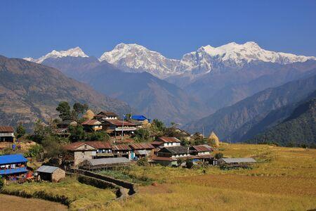 Landscape near Bhulbhule, Annapurna Conservation Area. Village and snow capped Manaslu range. Stock Photo