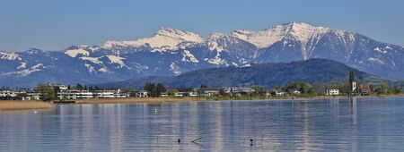 View from Rapperswil towards the snow capped mountain Grosser Speer.