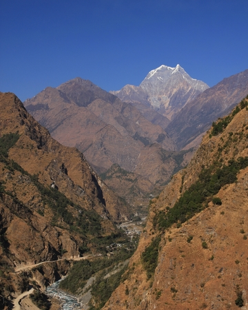 Distant view of Tatopani and mount Nilgiri. Popular place with natural hot spring. Annapurna Conservation  Area, Nepal