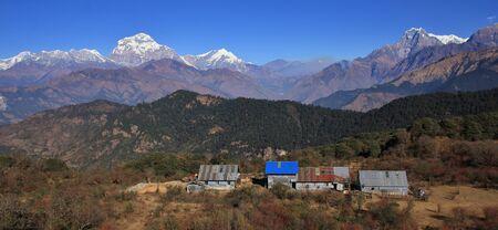 Scene on the way to Mohare Danda, Nepal. Dhaulagiri range and Nilgiri. Simple hotels. Stock Photo