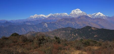 Autumn day in Nepal. Dhaulagiri range seen from a place near Poon Hill. Stock Photo