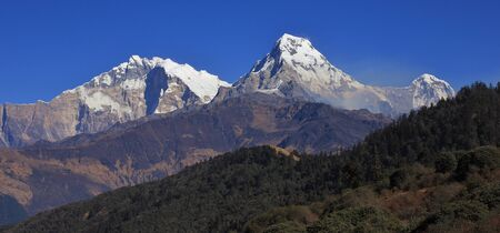 Poon Hill and mountains of the Annapurna range, Nepal. Popular travel destination. Stock Photo