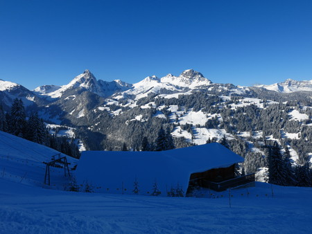 View from the Hohe Wispile ski area, Gstaad. Snow covered mountain Videmanette.