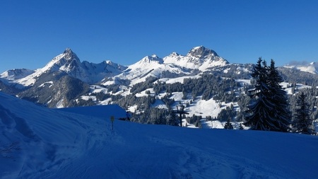 Middle station of the Hohe Wispile ski area. Winter landscape in Gstaad, Switzerland.