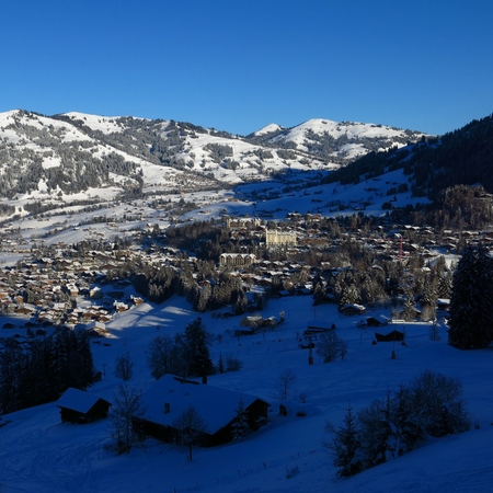 Famous village Gstaad on a winter morning. Stock Photo