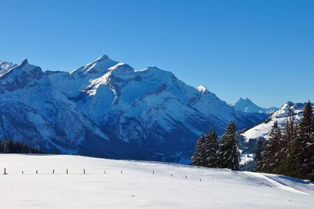 Winter day in the Swiss Alps. View from mount Hohe Wispile.